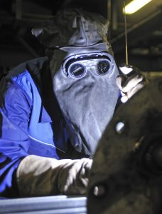 welder with goggles