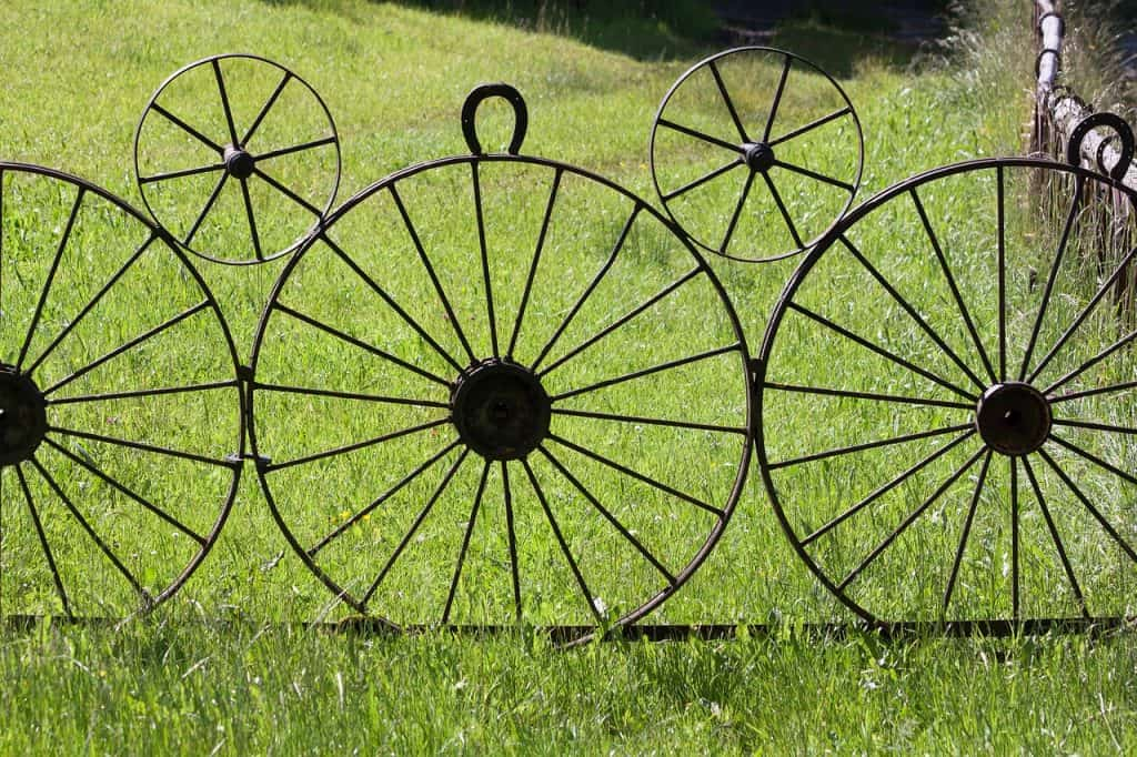 wagon wheels welded together resulting in a fence